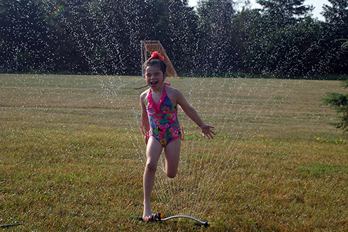 The city has re-opened parks to limited use. Willow Bassett, 6, stays cool in Corkery. Photo by Jake Davies