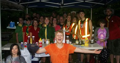 The First West Carleton Scouts and Ventures braved nasty weather to bring burgers to the masses. Photo by Jake Davies