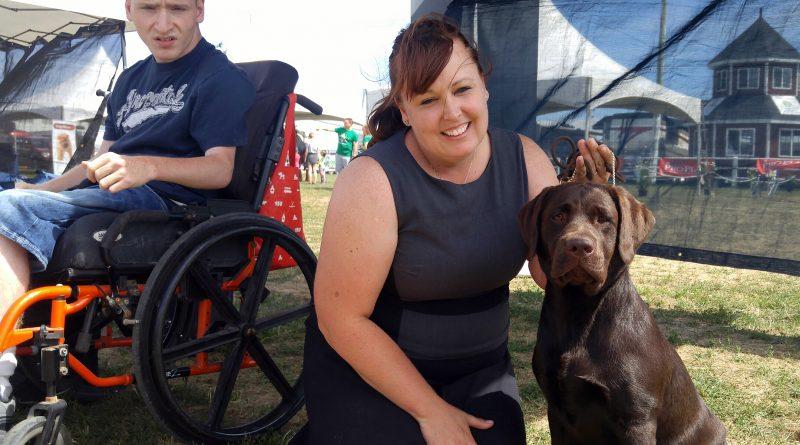 Angela Cotton, her son Jordan and her chocolate lab Ellie Sue.