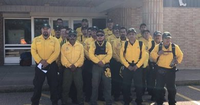 Mexican firefighters pose for a photo at the Pembroke airport before going to work. Photo courtesy Pembroke and Area Airport