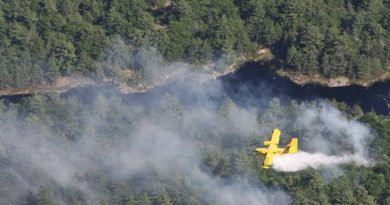 An MNR water bomber makes a run over a Renfrew County forest fire. Photo submitted