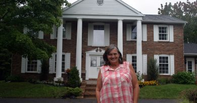 Owner Debbie Bernhardt poses outside of Windsong Manor in Corkery. Photo by Jake Davies