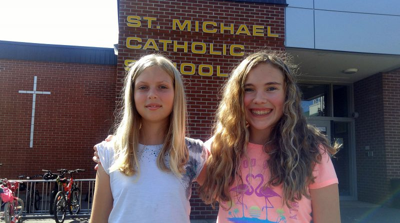 From left, St. Michael's Catholic School Grade 8 students Marley Brodersen and Eowyn Tomiczek are Space Cup inventors. Photo by Jake Davies