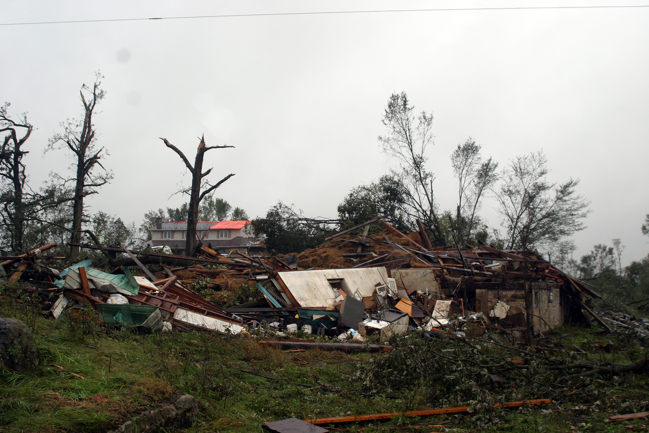 This was the stie of three barns, a silo and a two-acre maple tree forest on Woodkilton - all gone following Friday's tornado. Photo by Jake Davies