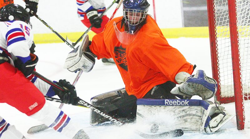 West Carleton Inferno goalie Alex Miotla turns aside a few ounces of rubber and a pound of snow during the team's third and final pre-season game on Sept. 18 in Stittsville. The new West Carleton Jr. C team plays its first home opener at W. Erskine Johnston Arena on Saturday, Oct. 6 at 8:15 p.m. versus the Metcalfe Jets. Photo by Nevil Hunt