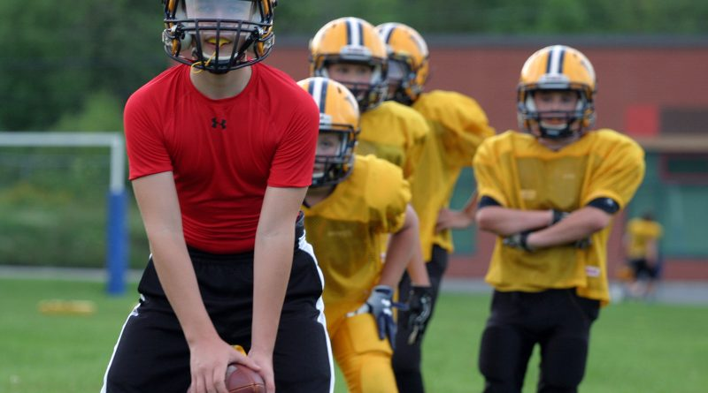 Quarterback Jake Glofcheskie practices handoffs during a Tuesday Wolverines practice last week. Photo by Jake Davies