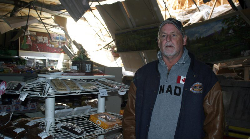 Mike Fines stands inside Dunrobin Meat and Grocery two days after the tornado roared through Dunrobin. Photo by Jake Davies