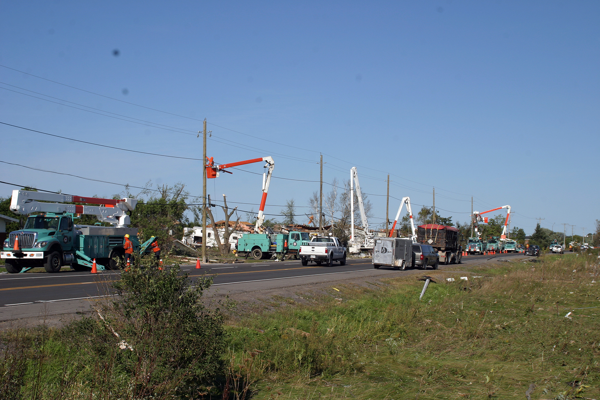 Hydro crews line the Dunrobin Side Road working hard to restore power to the neighbourhood. Photo by Jake Davies