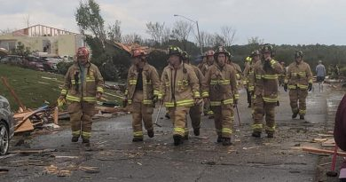 First responders survey damage following the Sept. 21 tornado. Photo by Nicole Novotny