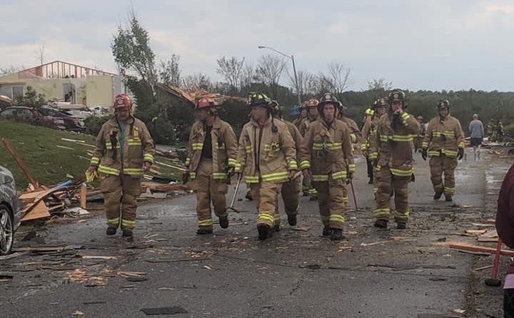 First responders survey damage following the Sept. 21 tornado. Photo by Nicole Novotny