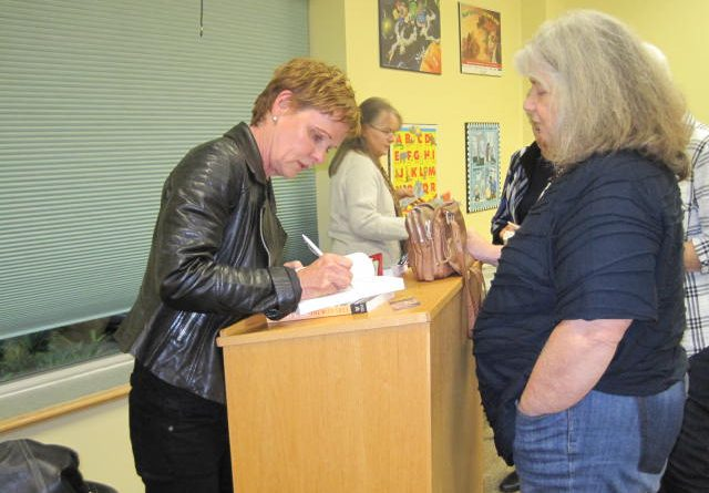 Author Dorothy Speak signs a book at the Carp library on Oct. 10. Photo by Librarian Lori Fielding