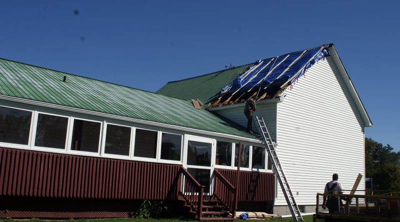 Contractors were busy working on the Galetta Community Centre roof on Oct. 4. The roof was torn off by a suspected microburst on Sept. 21. Photo by Jake Davies