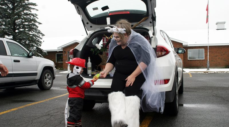 Kinburn's third annual Trunk or Treat was its biggest yet despite Sunday's first snow fall of the year. Photo by Jake Davies