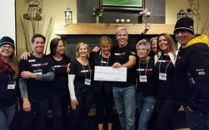 Organizers of #DunrobinProud share the efforts of their fundraising with West Carleton Disaster Relief's co-chair Greg Patacairk. Photo submitted