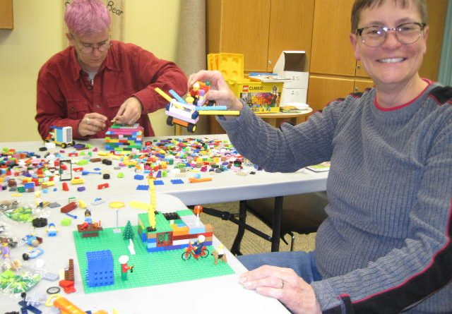 Masterbuilders at work at the Carp library's adult-only Lego party. Photo by Lori Fielding