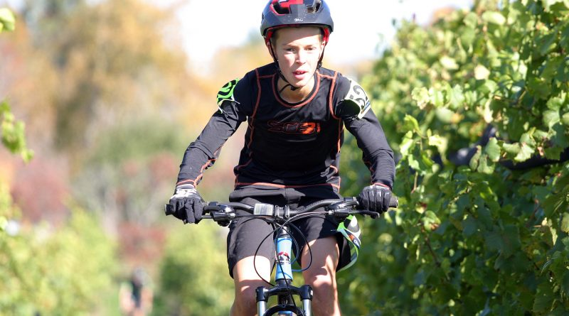 Carp's Noah Vanderzon, 12, races through the KIN Vineyard in Carp during Sunday's cyclocross race. Photo by Jake Davies