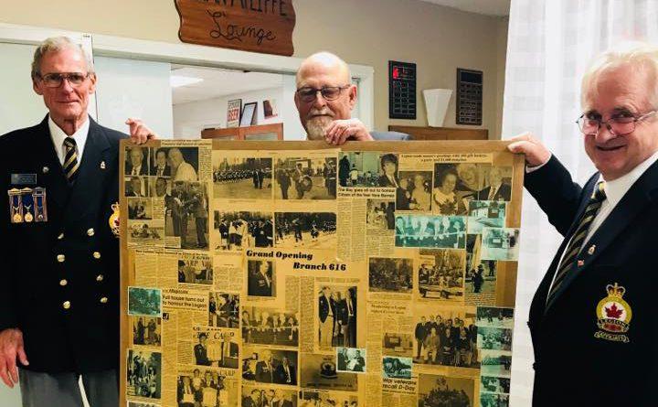 Legion President George Dolan, VPs Jim Wilson and Bogdan Procyk hold up 50 years of headlines at the Legion's 50th anniversary. Photo by Arleen Morrow