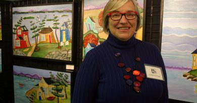 West Carleton Art Society member Heather Lovat-Fraser poses in front of her work at the Expressions of Art 2018 show, Saturday, Oct. 6. Photo by Jake Davies