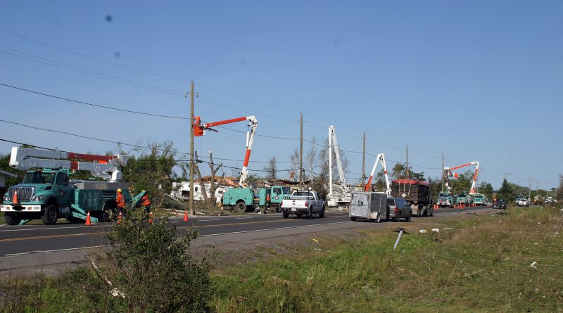 Hydro crews work furiously along Dunrobin Road to restore power back to the community shortly after the tornado. Photo by Jake Davies