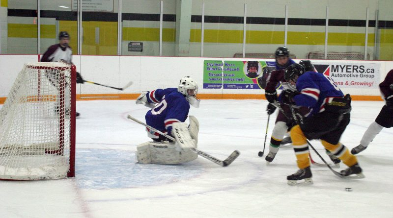 Wolves goalie Nick MacIsaac battles hard to help earn a 4-4 tie against St. FX on Oct. 24. Photo by Jake Davies
