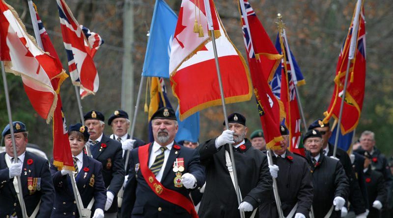 The Branch 616 colour party parades down Allbirch Street on its way to the Legion. Photo by Jake Davies