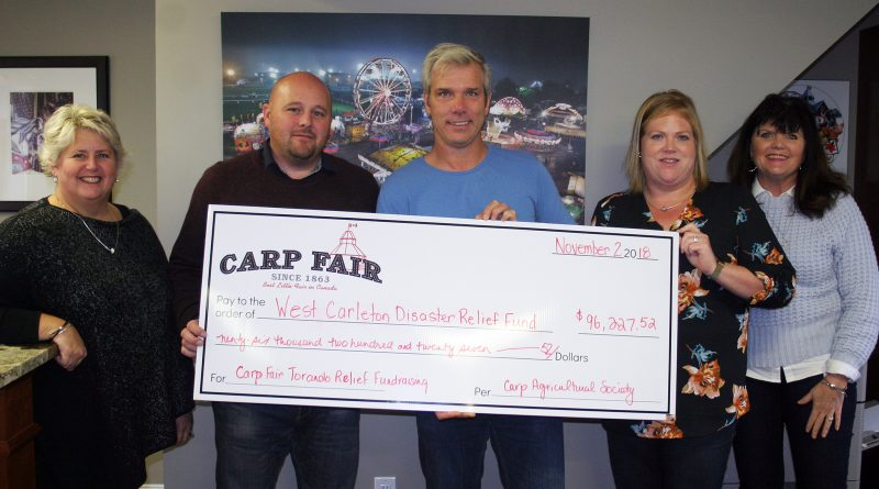 The Carp Fair presents a huge cheque to WCDR. From left is the Carp Fair's Lynne Hudson, Chad Findlay, WCDR co-chair Greg Patacairk, Lisa Belton and Nancy Ziebarth. Photo by Jake Davies