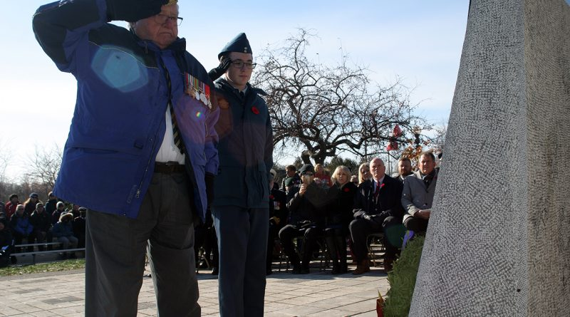 West Carleton's last surviving World War II veteran, Dr. Roly Armitage, salutes at the West Carleton War Memorial at last year's service. Photo by Jake Davies