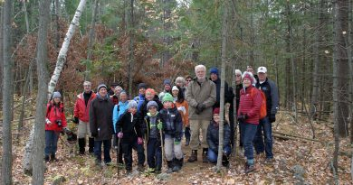 The Friends of the Carp Hills, and some friends of the Friends of the Carp Hills pose for a photo during an Oct. 21 fall colours guided tour. Photo by Jake Davies