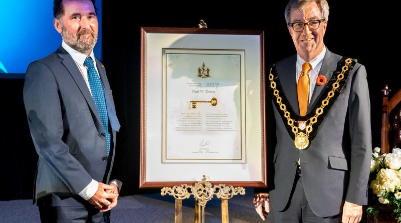 Paul Dewar, left, receives the Key to the City from Mayor Jim Watson. Photo submitted