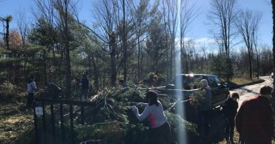 More than 20 volunteers were hard at 'er Sunday morning cleaning up six properties in the Dunrobin area. Photo courtesy Scott Hamilton