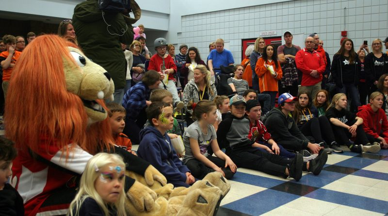 Sparty and several of the children in attendance listen to program details. Photo by Jake Davies
