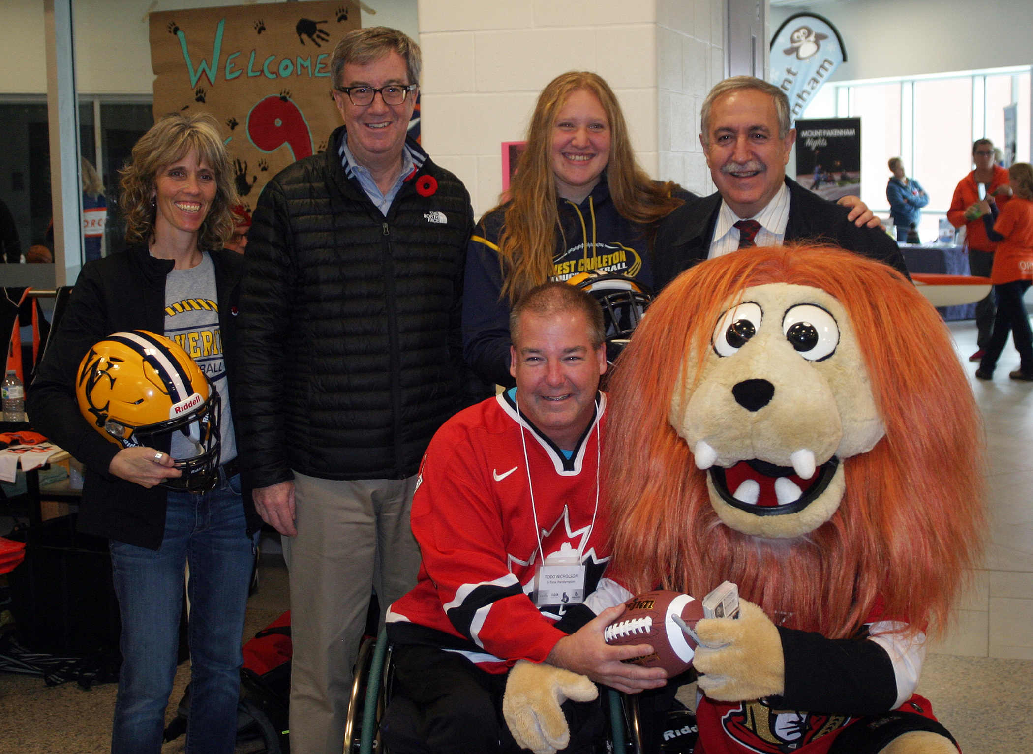 From left, West Carleton Wolverine's Natalie McArdle, Mayor Jim Watson, Wolverine B Cup winner Brooke Bean, Coun. Eli El-Chantiry and up front Todd Nicholson and Sparty were all at the The Rebuilding Our Communities Through Sport event last Saturday. Photo by Jake Davies