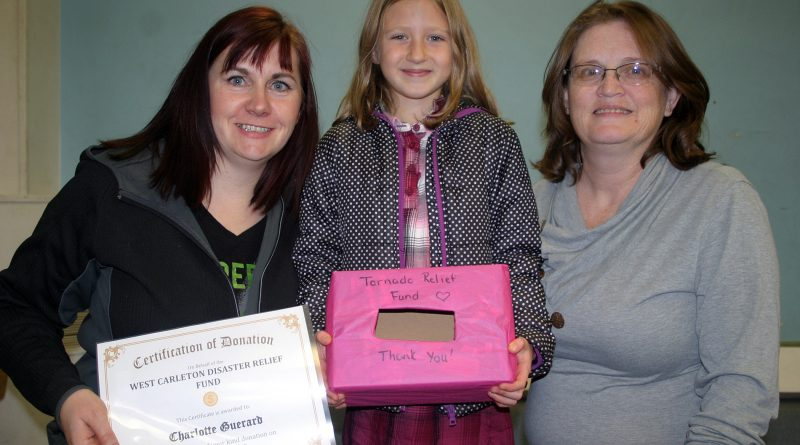 From left, WCDR's Lori McGrath, Charlotte Guerard and WCDR's Laurie Chauvin pose with the donation. Photo by Jake Davies