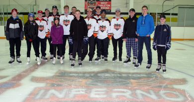 West Carleton Inferno players skate with some of their young fans during a community skate the team hosted Saturday. Photo by Jake Davies