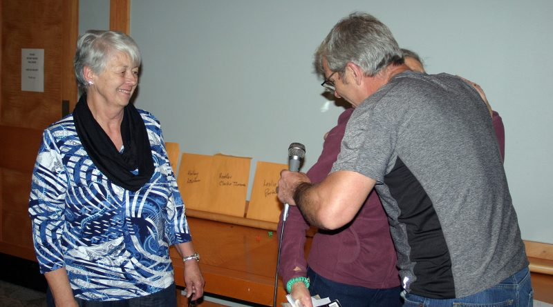 WCDR co-chair Greg Patacairk gives the WCFAC's Mary Braun a hug along with WCFAC's Sharon Roper moments after the donation was made, Nov. 6. Photo by Jake Davies