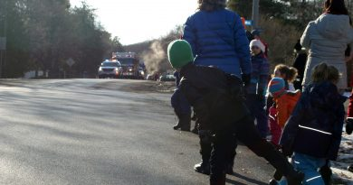 An anxious, young Constance Bay resident can't wait for the parade to arrive. Photo by Jake Davies