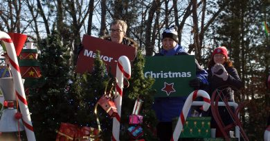 Coun. Eli El-Chantiry and Mayor Jim Watson participate in this year's Constance Bay Santa Day in the Bay parade, Dec. 1. Coun. Chantiry's food drive ends this week. Photo by Jake Davies