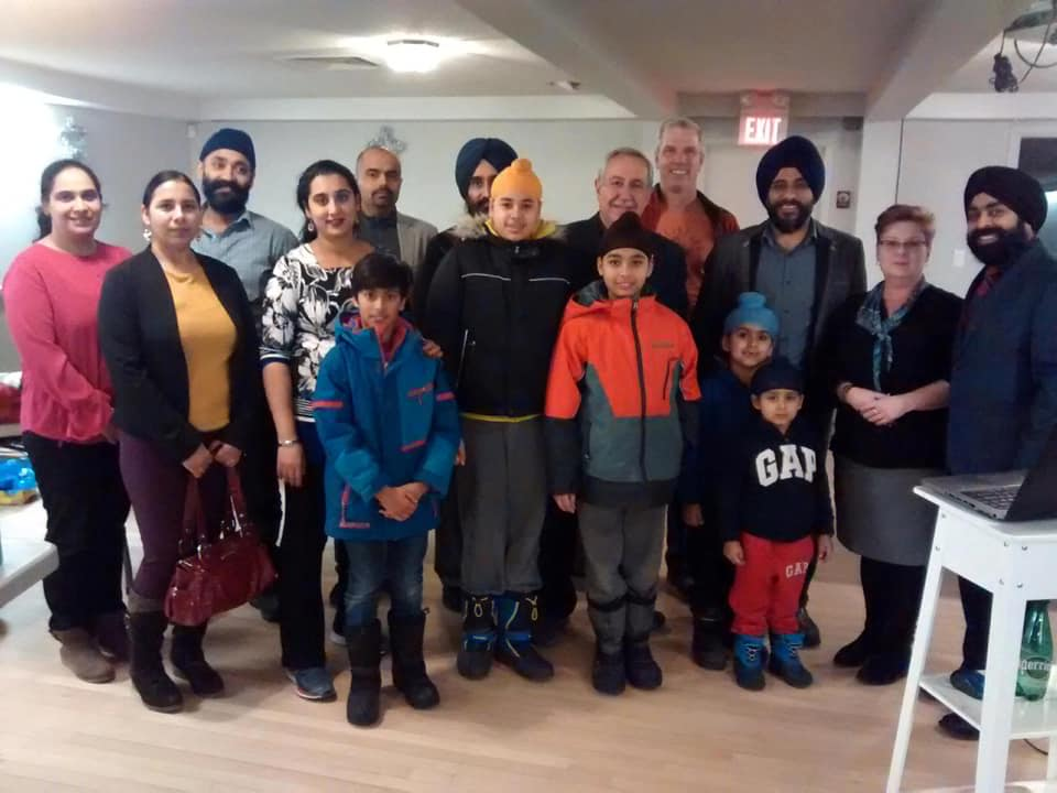 Supinderjit Singh and his team from UFoundation presented gift certificates to families displaced by the Sept. 21 tornado. Courtesy Supinderjit Singh