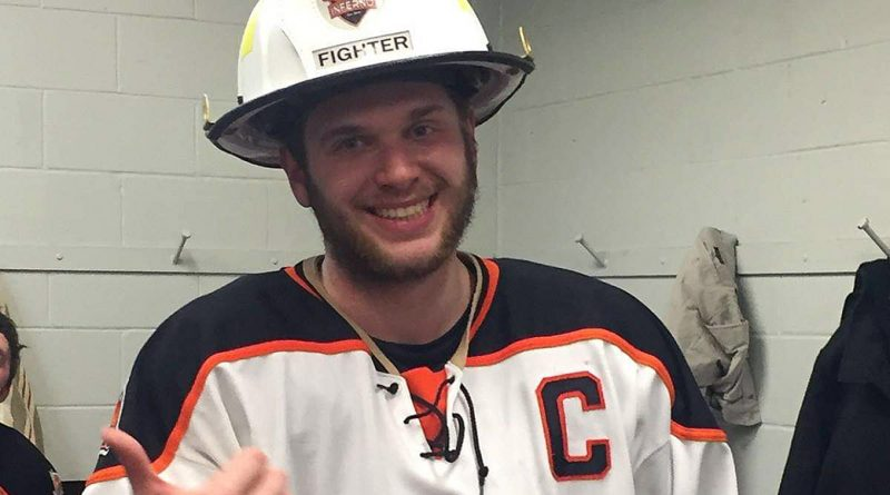 Inferno Captain Nick Sourges was all smiles after being awarded the player of the game by his teammates and getting to wear the cool POG helmet provided by Canadian Safety Products. Courtesy the West Carleton Inferno