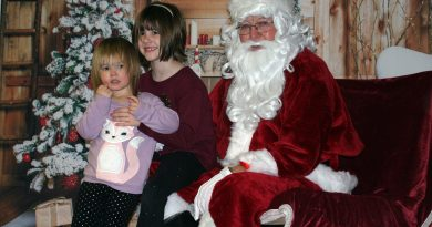 Santa talks with Piper, 2, and Braelyn, 7, Lesnick at Breakfast with Santa, Sunday last year. Photo by Jake Davies