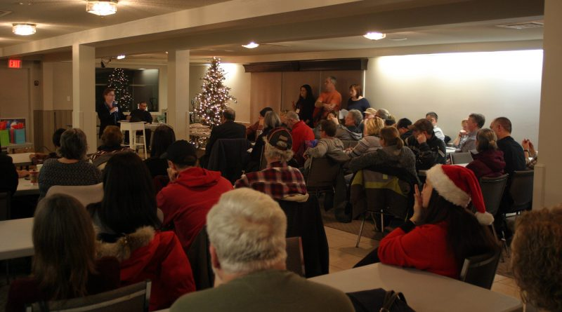WCDR vice president Angela Bernhardy addresses about 75 people at the last tornado recovery meeting of 2018 last night (Dec. 20). Photo by Jake Davies