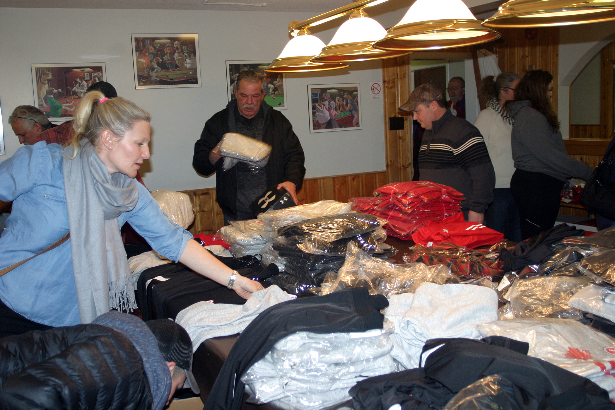 Dunrobin resident Emily Glossop-Nicholson sorts the huge donation of clothing and footwear her and her husband were able to secure. Photo by Jake Davies
