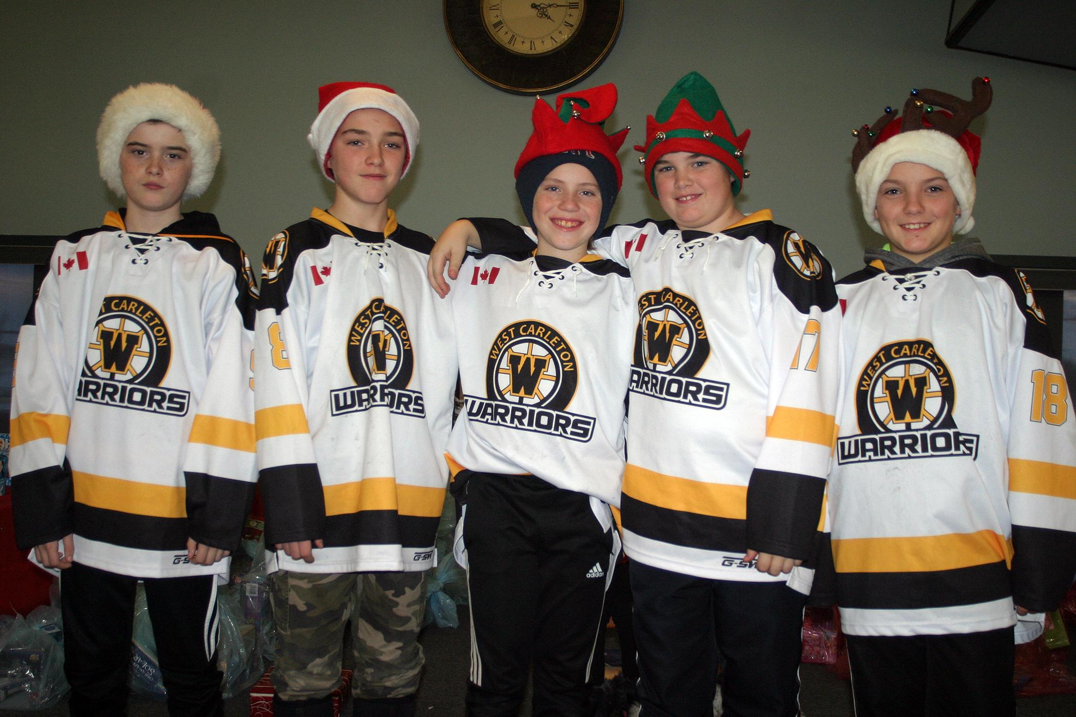 The West Carleton Warriors Pee Wee A team volunteered their time as Santa's elves. Photo by Jake Davies