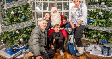 After the parade many headed to the Carp Commons Presentation Centre for a chance for a photo and heart-to-heart with Santa. In the photo Reid, Parker and Dawson Bishop sit with Santa along with grandparents Bill and Emily. Photo courtesy Michael Anderson Photography