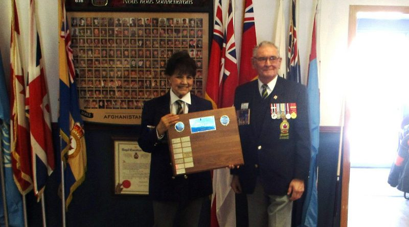 Branch 616's Arleen Morrow is presented her provincial plaque for scrapbooking by Zone Commander Bob Atkinson. Courtesy Facebook
