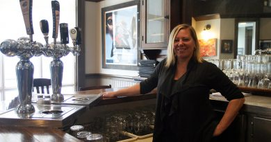 Co-owner Corri Greenberg behind the bar at The Juke Joint Soul Kitchen. Photo by Jake Davies