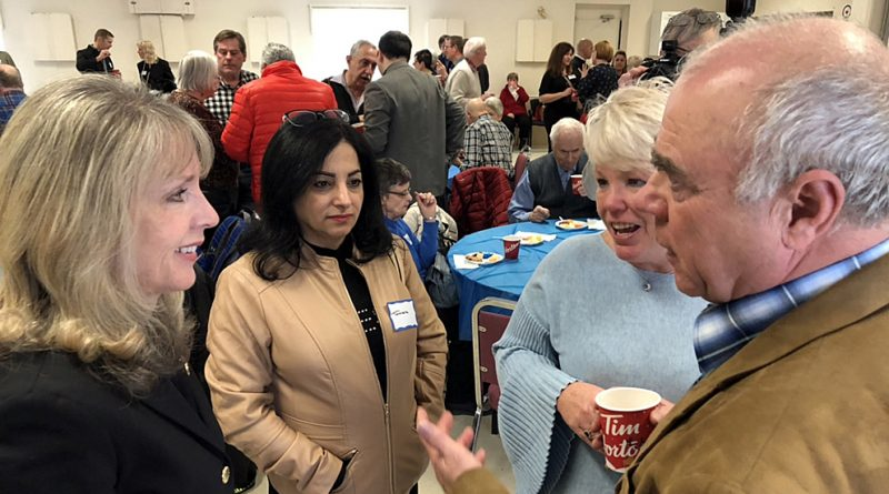 MPP Dr. Merrilee Fullerton talks with West Carleton residents including Constance Bay Pharmacy owner Tamara Awada (second from left) at the MPP's New Year Levee. Photo courtesy MPP Fullerton