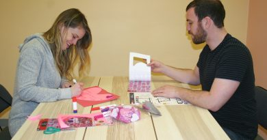 Stephanie Matas and Zach Moses work on their Valentine's Cards last Saturday as part of the Diefenbunnker's Valentines for Veterans program. Photo by Jake Davies