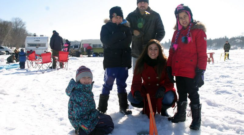 Last year's Kids Ice Fishing Derby had perfect weather for a day on the bay. Photo by Jake Davies