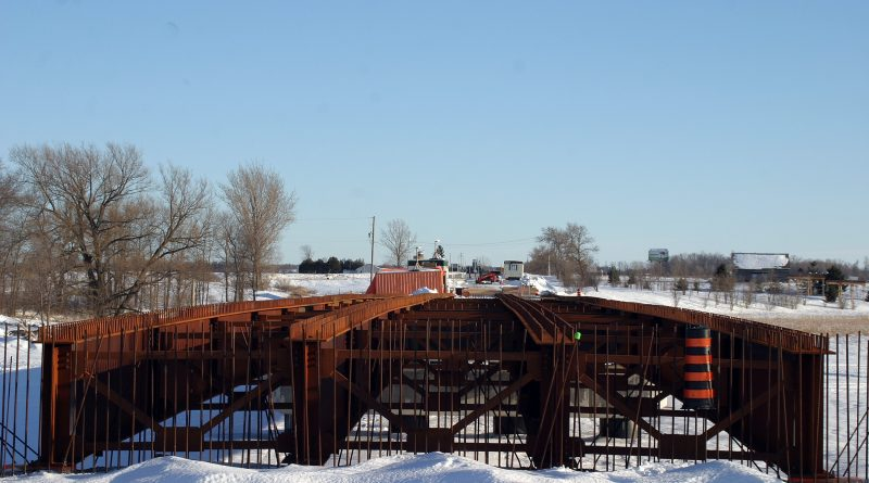 Reporter Jake Davies had to trudge through 1 km of knee deep snow (uphill both ways) to capture the steel girders of the new Old Hwy. 17 bridge over the Mississippi River. Photo by Jake Davies